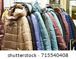 winter women's jackets on a... | Shutterstock . vector #715540408