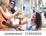 group of young female friends... | Shutterstock . vector #715542034