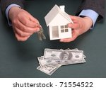 parts of hands with house and money - stock photo