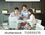 business coworkers discussing... | Shutterstock . vector #715553170