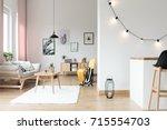 lighting in bright living room... | Shutterstock . vector #715554703