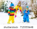 children build snowman. kids... | Shutterstock . vector #715555648