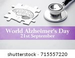 Small photo of World Alzheimer's Day, 21st September, health background concept. Puzzle with brain and stethoscope on grey background. Selective focus image.
