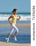 young woman jogging on the... | Shutterstock . vector #71556286