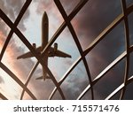 plane flies over airport | Shutterstock . vector #715571476