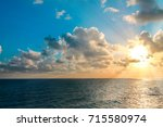 Small photo of Rays of sunlight over the ocean.