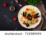 seafood fettuccine pasta with...   Shutterstock . vector #715589494