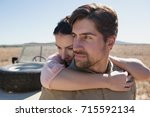 young man with woman standing... | Shutterstock . vector #715592134