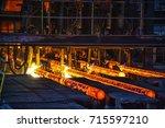 flame cutting hot ingot  | Shutterstock . vector #715597210
