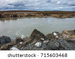 giant crater of unknown origin... | Shutterstock . vector #715603468