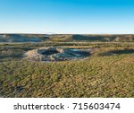 giant crater of unknown origin... | Shutterstock . vector #715603474