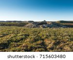 giant crater of unknown origin... | Shutterstock . vector #715603480