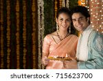 holding a tray of diyas   | Shutterstock . vector #715623700