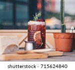 iced tea with lemon and... | Shutterstock . vector #715624840