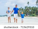 family of three   father with... | Shutterstock . vector #715629310