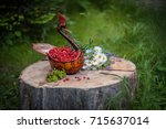 A Wooden Bowl In The Form Of A...