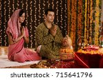 couple performing a pooja   | Shutterstock . vector #715641796