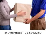 woman customer receiving the... | Shutterstock . vector #715643260