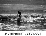 Small photo of DEAL, NEW JERSEY - September 13, 2017: Surfers soak up the last bit of summer and enjoy the swells from Hurricane Jose