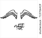 angel wings vector  lettering ... | Shutterstock .eps vector #715706419