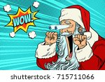 wow santa claus christmas... | Shutterstock .eps vector #715711066