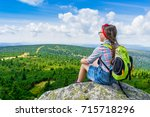 young travel girl sitting on... | Shutterstock . vector #715718296