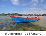 small fishing boats anchored on ... | Shutterstock . vector #715726240