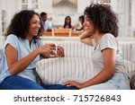 mother talking with teenage... | Shutterstock . vector #715726843