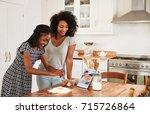 teenage girls following recipe...   Shutterstock . vector #715726864