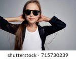 schoolgirl with glasses... | Shutterstock . vector #715730239