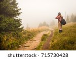 active senior stands alone on... | Shutterstock . vector #715730428