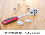 block wrench on wooden table... | Shutterstock . vector #715734103
