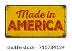 Small photo of Vintage rusty metal sign on a white background - Made in America