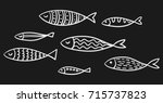 set of vector stylized fishes.... | Shutterstock .eps vector #715737823