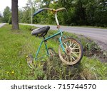 rusty abandoned three wheeled... | Shutterstock . vector #715744570