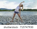 young woman practicing yoga at... | Shutterstock . vector #715747930