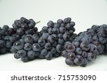 branches of blue grapes... | Shutterstock . vector #715753090