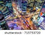 traffic speeds through an... | Shutterstock . vector #715753720