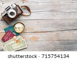 camera  compass  passports and... | Shutterstock . vector #715754134