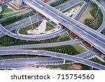 city highway interchange in... | Shutterstock . vector #715754560
