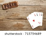 poker sign and four aces on... | Shutterstock . vector #715754689