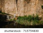 reflection of people stand and...   Shutterstock . vector #715754830