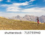 hiker man walking on the... | Shutterstock . vector #715755940