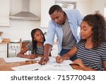 father helping two daughters... | Shutterstock . vector #715770043