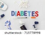 word diabetes with insulin... | Shutterstock . vector #715778998