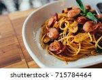 spaghetti spicy sausage | Shutterstock . vector #715784464