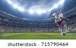 soccer player kicks the ball on ... | Shutterstock . vector #715790464