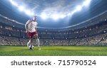 soccer player kicks the ball on ... | Shutterstock . vector #715790524