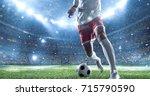 soccer player kicks the ball on ... | Shutterstock . vector #715790590