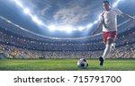 soccer player kicks the ball on ... | Shutterstock . vector #715791700